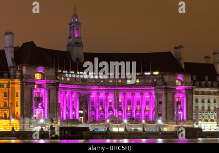 Nigh time at an illuminated County Hall, South Bank, London SE1, United Kingdom - Stock Photo