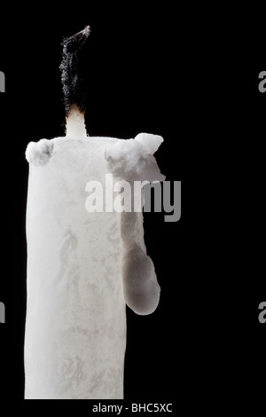 unlit white candles on black background - Stock Photo