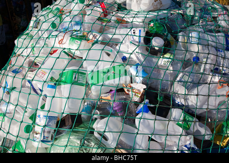 Plastic waste for recycling at recycling collection station in car park UK - Stock Photo