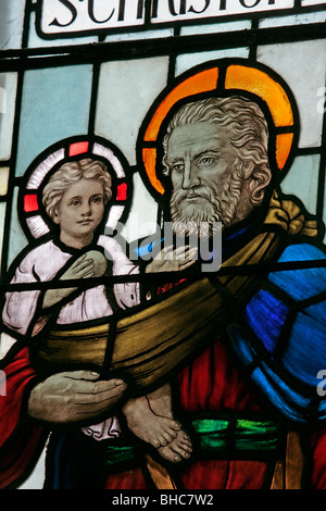A stained glass window depicting Saint Christopher carrying the infant Jesus, St Mary's Church, Leake, North Yorkshire - Stock Photo