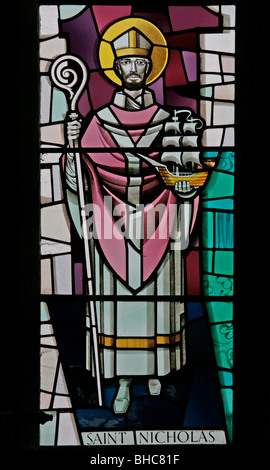 A modern stained glass window depicting Saint Nicholas of Myra, by Harry Harvey, St Mary's Church, Leake, North - Stock Photo