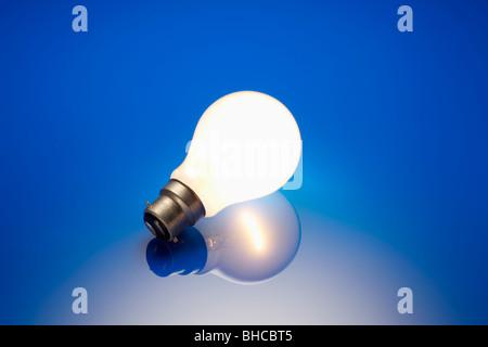 Standard Light Bulb Illuminated - Stock Photo