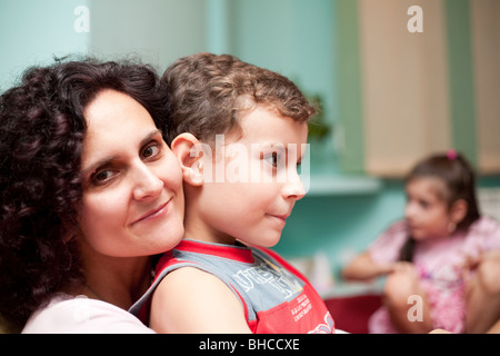 Mother and son having a good time, indoor shot - Stock Photo