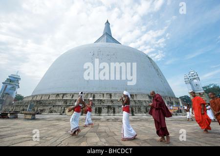 A Buddhist parade at Ruwanweliseya Anuradhapura Sri Lanka - Stock Photo