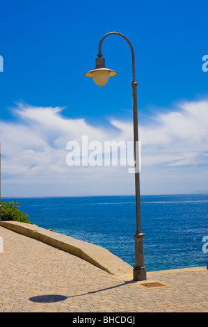 Lamp post against blue sky - Stock Photo