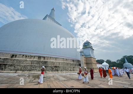 A Buddhist parade at Ruwanweliseya dagoba Anuradhapura Sri Lanka - Stock Photo