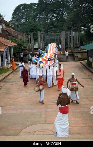 A traditional Buddhist parade at Ruwanweliseya dagoba Anuradhapura Sri Lanka - Stock Photo