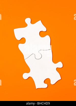 Orange white Puzzle pieces elevated view - Stock Photo