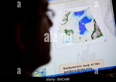 Thorarinn S. Arnarson, Oceanographer and Hydrocarbon Licensing Manager, shows a map of the Dreki area. NEA in Reykjavik, - Stock Photo