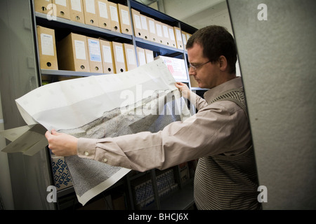 Thorarinn S. Arnarson, Oceanographer and Hydrocarbon Licensing Manager, shows a map with seismic reflection lines... - Stock Photo