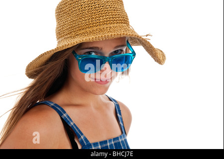 Pretty teen girl in blue sunglasses and a straw hat - Stock Photo