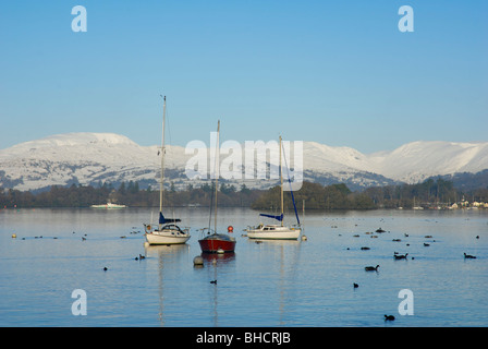 Boats  - and ferry - on Lake Windermere in winter, Lake District National Park, Cumbria England UK - Stock Photo