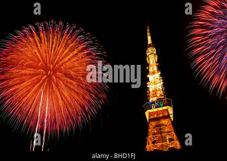 Fireworks display above Tokyo Tower, Minato-ku, Tokyo, Japan - Stock Photo