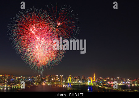 Fireworks display over Odaiba, Minato-ku, Tokyo, Japan - Stock Photo