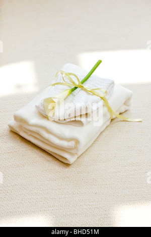 Folded towels with lily - Stock Photo