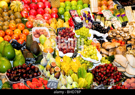 Fruits and vegetables for sale at La Boqueria, Barcelona Spain - Stock Photo
