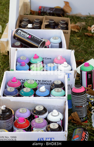 Spray cans of paint used by graffiti 'artists' - Stock Photo