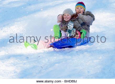 Children on sledges in Winter in Stonesfield ,Oxfordshire - Stock Photo