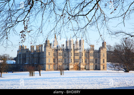 Burghley House viewed in the snow - Stock Photo