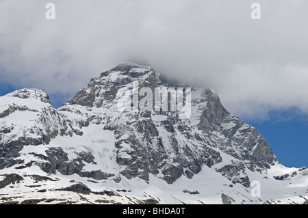 Italian side of the cloud capped Matterhorn or il Monte Cervino from village of Breuil Cervinia Italy - Stock Photo