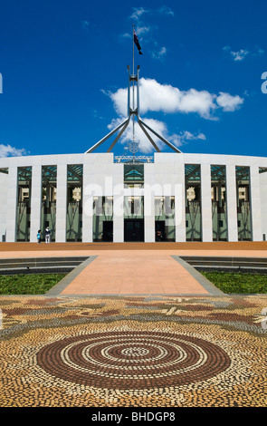 CANBERRA, Australia - The front of Parliament House, featuring an aboriginal tiled design on the ground. Parliament House is the meeting place of the Parliament of Australia. It is located in Canberra, the capital of Australia. It was opened on 9 May 1988 by Queen Elizabeth II, Queen of Australia.[1] Its construction cost was over $1.1 billion. At the time of its construction it was the most expensive building in the Southern Hemisphere. Prior to 1988, the Parliament of Australia met in the Provisional Parliament House, which is now known as 'Old Parliament House'.