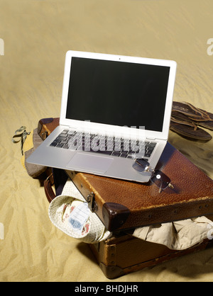 Travelling with a laptop computer - Stock Photo