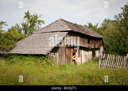 Abandoned house in the countryside near a forest - Stock Photo