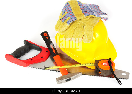 Protection helmet, gloves and construction tools isolated on white background - Stock Photo