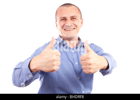 Portrait of a young happy businessman showing thumbs up sign, isolated on white background - Stock Photo