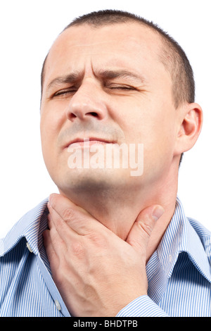 Young man with throat pain isolated on white background - Stock Photo