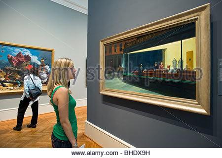 Admiring Edward Hopper's 'Nighthawks' painting at the Art Institute of Chicago. Chicago, Illinois, usa - Stock Photo