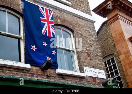 An Australian Flag hangs on the front of a pub on the Fulham Road, London - Stock Photo