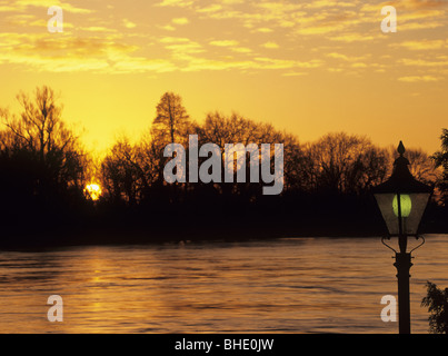 Wargrave, Berkshire, England, UK. Sunset over the River Thames in flood - Stock Photo
