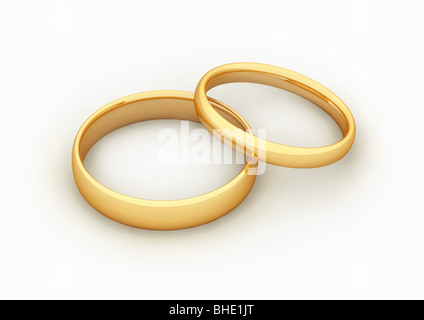 2 golden rings, symbol for marriage / fusion - 2 goldene Ringe, Symbol für Fusion / Heirat - Stock Photo