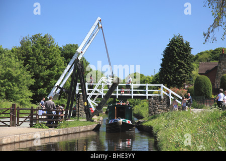 A narrowboat going under Froncysyllte Lift Bridge on the Llangollen Canal - Stock Photo