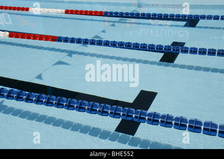 empty olympic type swimming pool with lanes stock photo