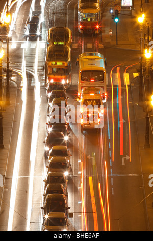 prague - high angle view of traffic on cechuv bridge at dusk - Stock Photo