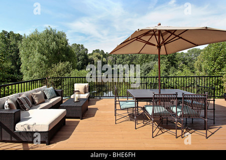 Deck of luxury home with water view - Stock Photo
