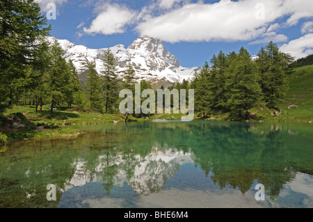 Il Lago Blu or the Blue Lake in Valtournenche Italy with the peak of the Matterhorn or Il Cervino in the background. - Stock Photo