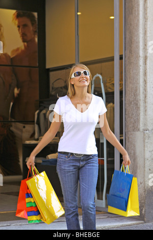 happy young woman goes shopping - Stock Photo