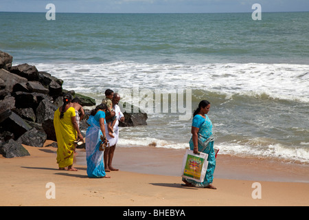 Walking along the beach in Mamallapuram, Tamil Nadu, India - Stock Photo