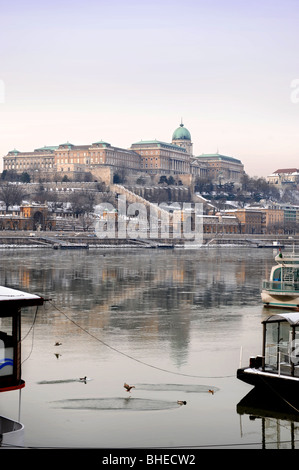 Winter view of Buda Castle with The Royal Palace from the Pest banks of the Danube in Budapest Hungary - Stock Photo