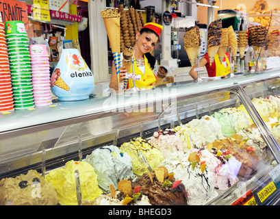 Young woman selling Italian ice cream varieties in summer holiday resort town of Sirmione on Lake Garda, Lombardy, - Stock Photo