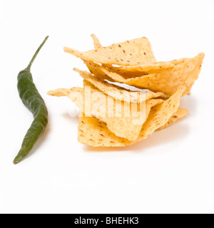 Pile of Tortilla Chips with large green chili isolated against white background. - Stock Photo