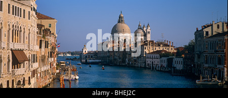 Panoramic view down the Grand Canal towards the Santa Maria Della Salute with gondolas and boats, Venice, Italy, - Stock Photo