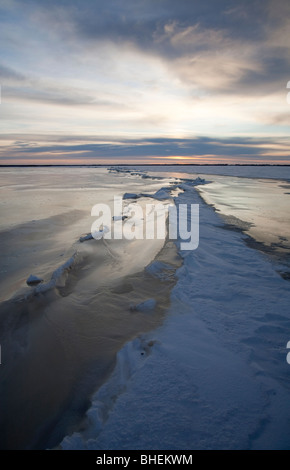 Pressure zone and cracks on sea ice - Stock Photo