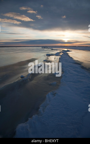 Pressure ridge and a long crack on sea ice at Baltic Sea , Gulf of Bothnia , Finland - Stock Photo
