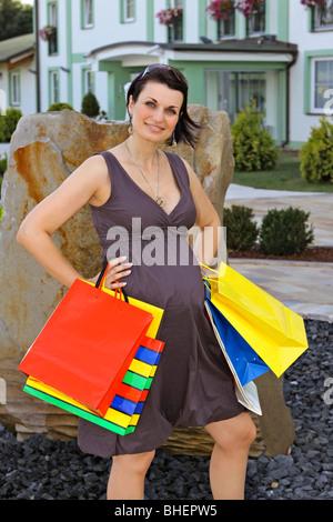 pregnant woman at shopping, Schwangere Frau beim Einkaufsbummel - Stock Photo