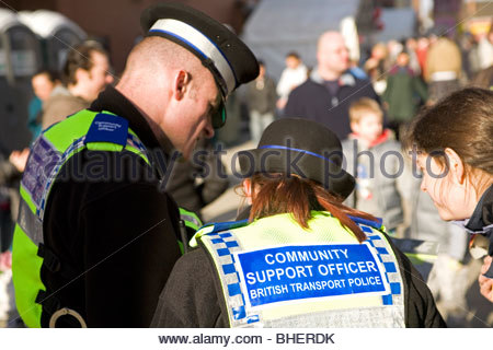 Community Support Officers provide support to a member of the public in the United Kingdom. - Stock Photo