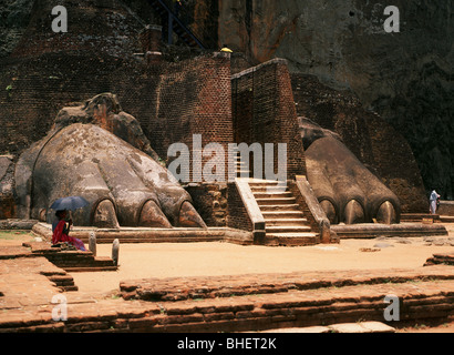 Entrance stairs to the Sigiriya rock fortress between giant lion's claws, Sri Lanka - Stock Photo